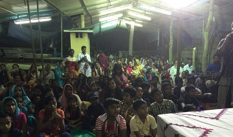 Proclaiming the Gospel in a home in Kerala